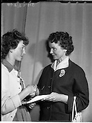 22/05/1959<br /> 05/22/1959<br /> 22 May 1959<br /> Gael Linn Singing Competition at Dun Laoghaire. Maureen Cusack (right) wife of Cyril Cusack presenting the 1st prize of &pound;10 and Radio Audition to 15 year old ex-Dominican Convent, Dun Laoighaire singer Ursula N&iacute; Brennan, 31 Sallynoggin Park, Dun Laoghaire.