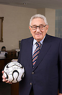 Dr. Henry Kissinger, former US Secretary of State and Nobel Peace Prize winner, in his office in New York City holding a soccer ball during the 2006 World Cup Soccer tournament  in Germany.