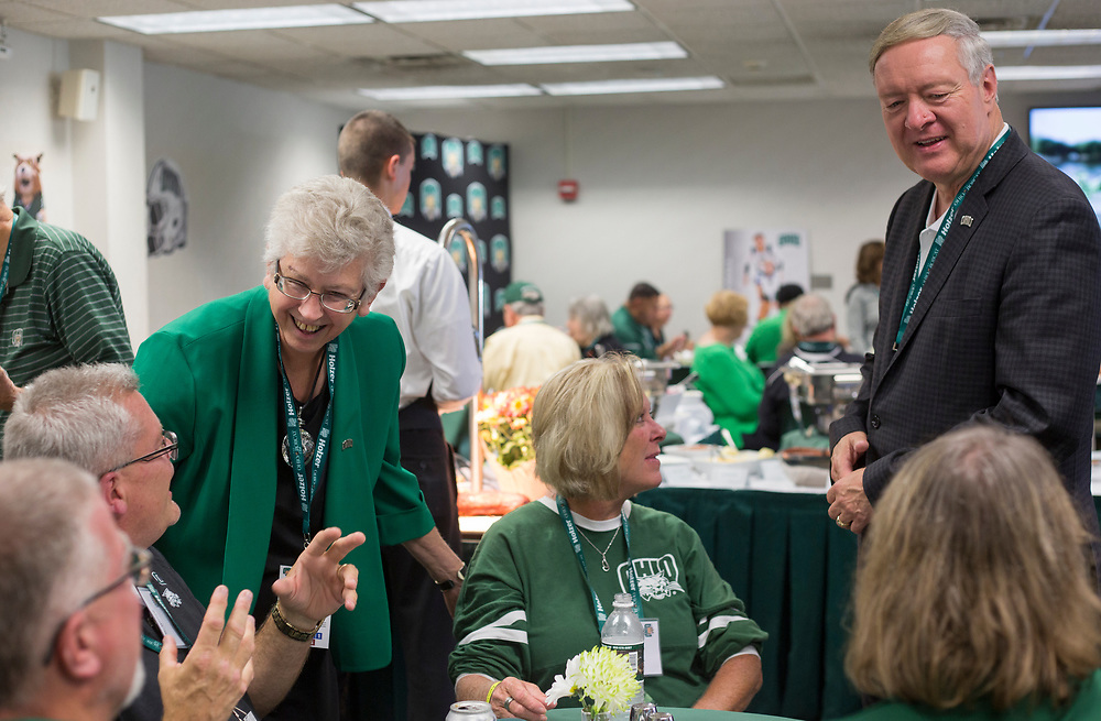 President Duane Nellis and Ruthie Nellis greet a table of guests on Sept. 2, 2017 in the Presidents box at Peden Stadium before the start of the football game against the Hampton Pirates.