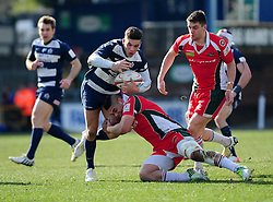 Bristol Inside Centre (#12) Ben Mosses is tackled  - Photo mandatory by-line: Dougie Allward/JMP - Tel: Mobile: 07966 386802 31/03/2013 - SPORT - RUGBY - Memorial Stadium - Bristol. Bristol v Plymouth Albion - RFU Championship.