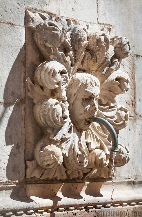 A sculpture (maskeron) on Onofrio's Fountain in the old city of Dubrovnik, Croatia.<br /> <br /> Dubrovnik serves as the official setting of &quot;King's Landing&quot; from the popular TV show &quot;Game of Thrones&quot;.
