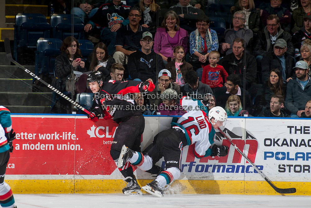 KELOWNA, CANADA - FEBRUARY 18: Sam Ruopp #2 of the Prince George Cougars checks Kole Lind #16 of the Kelowna Rockets into the boards during first period on February 18, 2017 at Prospera Place in Kelowna, British Columbia, Canada.  (Photo by Marissa Baecker/Shoot the Breeze)  *** Local Caption ***