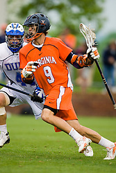 Virginia attackman Danny Glading (9) runs past Duke defenseman Tony McDevitt (44).  The #2 ranked Duke Blue Devils defeated the #3 ranked Virginia Cavaliers 11-9 in the finals of the Men's 2008 Atlantic Coast Conference tournament at the University of Virginia's Klockner Stadium in Charlottesville, VA on April 27, 2008.
