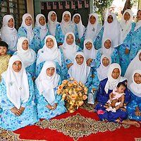 Malaysian Muslim pose for a gruop photograph after the 'berendoi' ceremony in Kuala Lumpur, Malaysia. Berendoi is part of malay tradition in welcoming newborn baby.