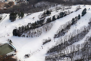 Aerial view of Tyrol Basin Ski Area, rural Dane County, Wisconsin in the winter on an overcast day.