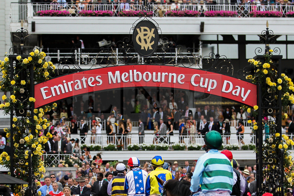 © Licensed to London News Pictures. 06/11/2012. Jockeys head back to the mounting yard after the race during the Emirates Melbourne Cup at the Flemington Racecourse, Melbourne. Photo credit : Asanka Brendon Ratnayake/LNP