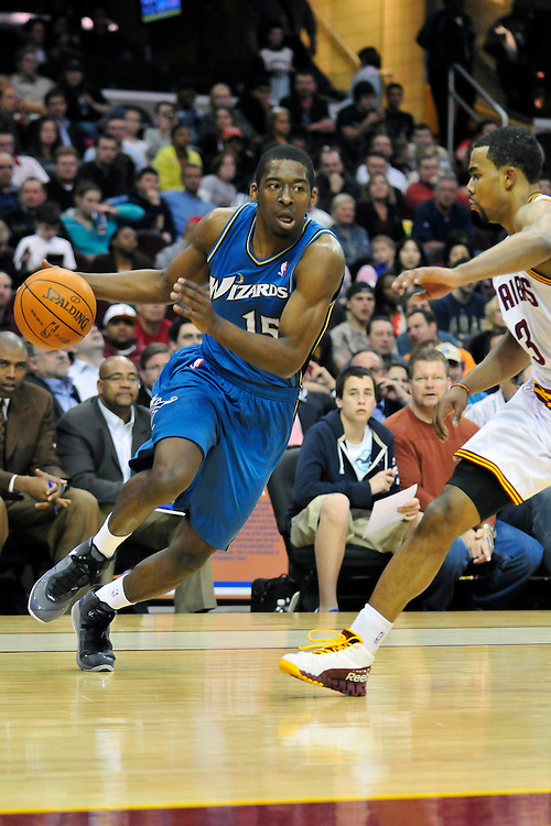 April 13, 2011; Cleveland, OH, USA; Washington Wizards shooting guard Jordan Crawford (15) drives past Cleveland Cavaliers point guard Ramon Sessions (3) during the third quarter at Quicken Loans Arena. The Cavaliers beat the Wizards 100-93. Mandatory Credit: Jason Miller-US PRESSWIRE