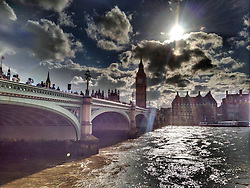 The late afternoon sun shines down on Big Ben in London. Photo taken on iPhone during a stroll along the South Bank of London.