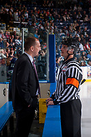 KELOWNA, CANADA - APRIL 30: Referee Steve Papp stands on the ice at the boards and speaks to Seattle Thunderbirds' head coach Steve Konowalchuk at the Kelowna Rockets on April 30, 2017 at Prospera Place in Kelowna, British Columbia, Canada.  (Photo by Marissa Baecker/Shoot the Breeze)  *** Local Caption ***