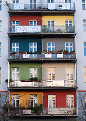 Colourful painted balconies on renovated apartment building in bohemian Prenzlauer Berg district of Berlin Germany