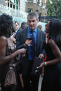 June Sarpong, Christopher Walley and Phoebe Vela. The Business Summer party hosted by Andrew Neil. Italian Hotel, Ritz Hotel. 12 July 2005. ONE TIME USE ONLY - DO NOT ARCHIVE  © Copyright Photograph by Dafydd Jones 66 Stockwell Park Rd. London SW9 0DA Tel 020 7733 0108 www.dafjones.com