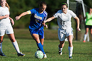 Milton's Caitlyn Dabagian (10) and Rice's Audrey Lynn (22) battle for the ball during the girls soccer game between the Milton Yellowjackets and the Rice Green Knights at Rice Memorial High School on Saturday afternoon October 3, 2015 in South Burlington. (BRIAN JENKINS/ for the FREE PRESS)