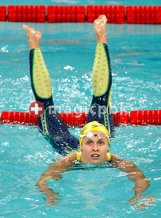 Lisbeth LENTON of Australia on her way out of the pool after winning the women's 100m Freestyle Final during day three of the 8th FINA World Swimming Championships (25m) held at Qi Zhong Stadium April 7, 2006 in Shanghai, China. (Photo by Patrick B. Kraemer / MAGICPBK)