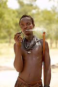 Namibia 2004, On the road from Epupa falls back to Opuwo I met a curious and friendly Himba clan. This man was smoking is pipe and slowly  exhaling.