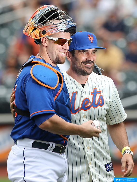 Modern Family actor Ty Burrell with New York Mets catcher John Buck after throwing out the first pitch before the New York Mets V Miami Marlins, Major League Baseball game which went for 20 innings and lasted 6 hours and 25 minutes. The Marlins won the match 2-1. Citi Field, Queens, New York. 8th June 2013. Photo Tim Clayton