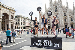 Models taking part in a PETA protest in Cathedral Square against the use of animal fur and leather during Milan Fashion Week, Milan Italy.
