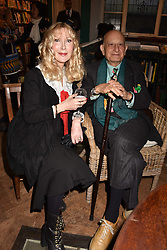 Basia Briggs and Naim Attallah at a party to celebrate the publication of Saving The World by Paola Diana at Daunt Books, Marylebone, London England. 2 May 2018.