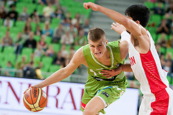 Edo Muric of Slovenia and Behnam Yakhchallidehkor of Iran during basketball match in the context of Telemach tournament between National Teams of Slovenia and Iran on August 21, 2014 in SRC Stozice, Ljubljana, Slovenia. Photo by Urban Urbanc / Sportida.com