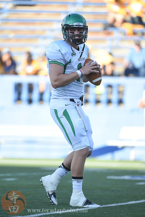 August 28, 2014; San Jose, CA, USA; North Dakota Fighting Sioux quarterback Joe Mollberg (14) warms up before the game against the San Jose State Spartans at Spartan Stadium.