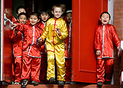 10/02/08-Victoria– Ethan Lai (R) calls out to his mother while students from the Chinese Language School of Victoria pour out to celebrate Chinese New Year in Canada's oldest Chinatown. (Photo by ARNOLD LIM/ Arnold Lim Photography)