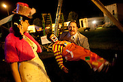 Greg Connors, manager of the Cole Bros. Circus and brother to the ringmaster, lifts up clown Perolito, a 5th generation clown in his 40s, in front of Alice, the ring mistress of the show, behind the circus tent during a show in Thomasville, Georgia...2009 marks the Cole Bros.'s 125th anniversary and the circus claims to be the oldest American circus under a tent. The 136 x 231 foot tent can house over 2,800 fans, along with several acts where the performers hail from all over the world.