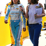 Race car driver Danica Patrick (L) is seen as he makes her way to the drivers meeting prior to the 58th Annual NASCAR Daytona 500 auto race at Daytona International Speedway on Sunday, February 21, 2016 in Daytona Beach, Florida.  (Alex Menendez via AP)