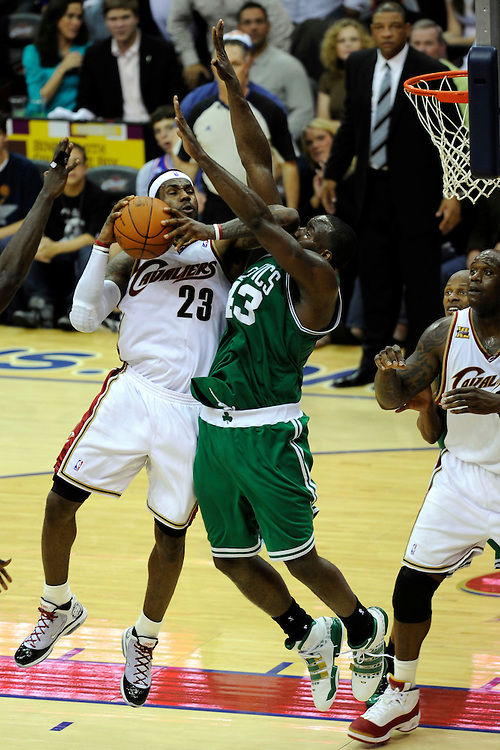 May 1, 2010; Cleveland, OH, USA; Cleveland Cavaliers forward LeBron James (23) shoots over Boston Celtics center Kendrick Perkins (43) during the fourth quarter of game one in the eastern conference semifinals in the 2010 NBA playoffs at Quicken Loans Arena. The Cavaliers beat the Celtics 101-93. Mandatory Credit: Dave Miller-US PRESSWIRE