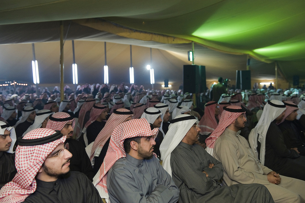 A crowd of Kuwaiti men listens to a speaker during a Jan. 23 election rally near Kuwait City organized by candidate Anwar Al-Dahoum.  More than 400,000 Kuwaiti men and women are eligible to cast ballots to choose from among some 320 men and women candidates currently in the running in the February 2, 2012 parliamentary polls to elect a new 50-member National Assembly (parliament).