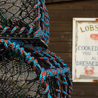 Lobster creels and old fashioned lobster and crab take away sign, Crail, Scotland