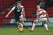 Ben Thompson of Millwall FC goes up against Richard Chaplow of Doncaster Rovers  during the Sky Bet League 1 match between Doncaster Rovers and Millwall at the Keepmoat Stadium, Doncaster, England on 27 February 2016. Photo by Ian Lyall.
