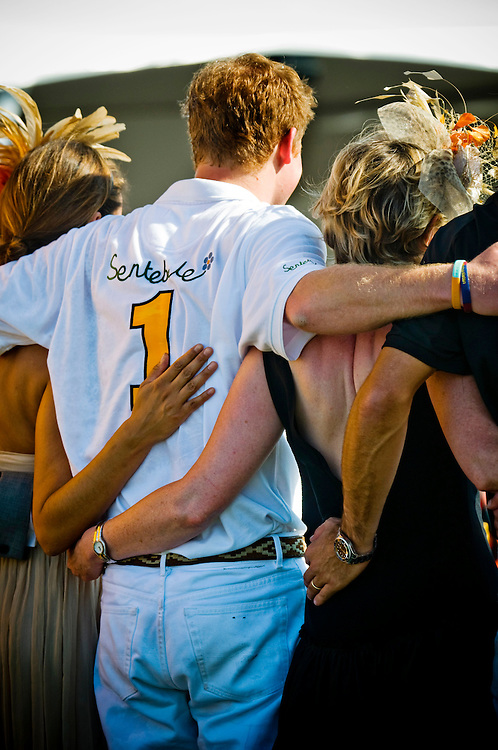 Prince Harry posing for photographs with fans and celebrities after the match of the 2009 Veuve Clicquot Manhattan Polo Classic.