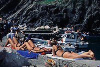 1997, Vernazza, Italy --- Young Women Sunbathing --- Image by © Owen Franken/CORBIS
