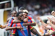 Jeffrey Schlupp (15) of Crystal Palace, Patrick van Aanholt (3) of Crystal Palace, celebrates after scoring goal during the Premier League match between Fulham and Crystal Palace at Craven Cottage, London, England on 11 August 2018.