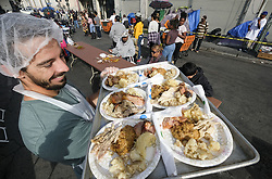 November 22, 2018 - Los Angeles, California, U.S - Volunteers serve Thanksgiving meal Thursday, in Los Angeles. Thousands of Skid Row residents and homeless people from downtown and beyond were served Thanksgiving dinners during the Los Angeles Mission's annual holiday feast. (Credit Image: © Ringo Chiu/ZUMA Wire)