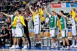 Slovenian team celebrates (Matjaz Smodis (8) of Slovenia, Jurica Golemac (14) of Slovenia, Primoz Brezec (7) of Slovenia, Jaka Klobucar (9) of Slovenia and Goran Dragic (11) of Slovenia)  during the EuroBasket 2009 Group F match between Slovenia and Poland, on September 14, 2009 in Arena Lodz, Hala Sportowa, Lodz, Poland.  (Photo by Vid Ponikvar / Sportida)