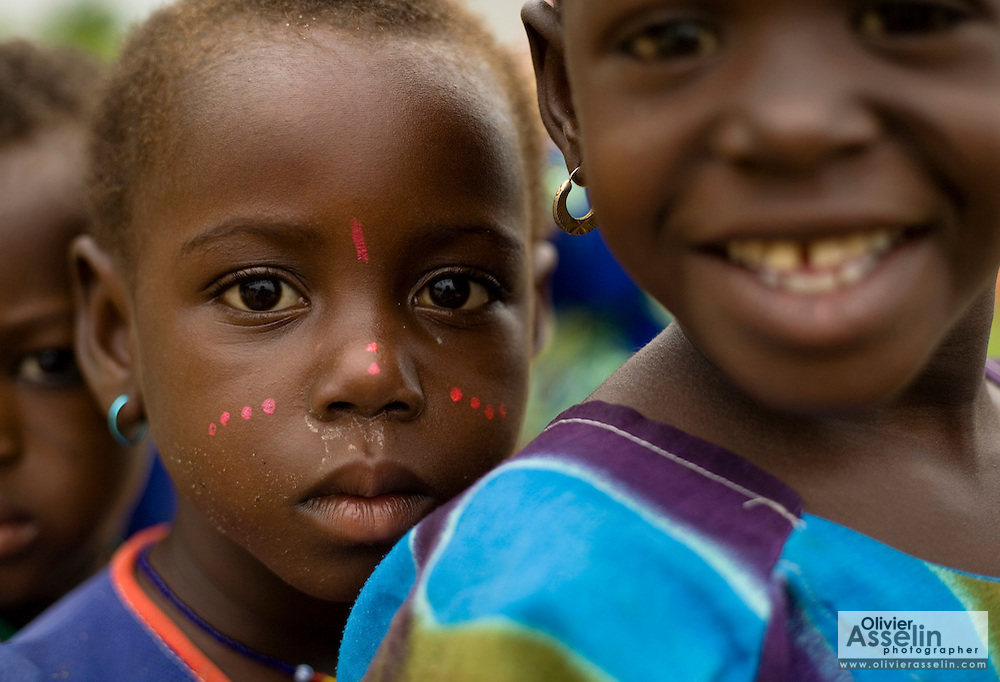Portrait of girl with face painting outside the Kotonli kindergarten in the village of Kotonli, northern Ghana, on Thursday June 7, 2007.