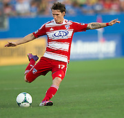 FRISCO, TX - JUNE 22:  Zach Loyd #17 of FC Dallas crosses the ball against Sporting Kansas City on June 22, 2013 at FC Dallas Stadium in Frisco, Texas.  (Photo by Cooper Neill/Getty Images) *** Local Caption *** Zach Loyd
