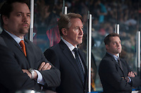 KELOWNA, CANADA - APRIL 18: Karl Taylor, Mike Johnston and Kyle Gustafson, coaching staff of the Portland Winterhawks stand on the bench against the Kelowna Rockets on April 18, 2014 during Game 1 of the third round of WHL Playoffs at Prospera Place in Kelowna, British Columbia, Canada.   (Photo by Marissa Baecker/Shoot the Breeze)  *** Local Caption *** Karl Taylor, Mike Johnston, Kyle Gustafson