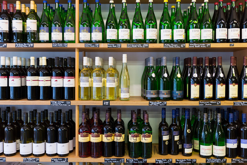 Shelves of bottles of German white and red wine on display in shop in Lubeck, Germany