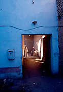 Blue wall and doorway with traditional men