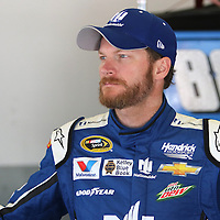 Sprint Cup Series driver Dale Earnhardt Jr. (88) is seen in the garage area during the 57th Annual NASCAR Coke Zero 400 practice session at Daytona International Speedway on Friday, July 3, 2015 in Daytona Beach, Florida.  (AP Photo/Alex Menendez)