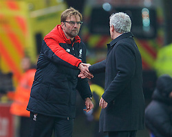 STOKE-ON-TRENT, ENGLAND - Tuesday, January 5, 2016: Liverpool's manager Jürgen Klopp shakes hands with Stoke City's manager Mark Hughes after the 1-0 victory during the Football League Cup Semi-Final 1st Leg match at the Britannia Stadium. (Pic by David Rawcliffe/Propaganda)