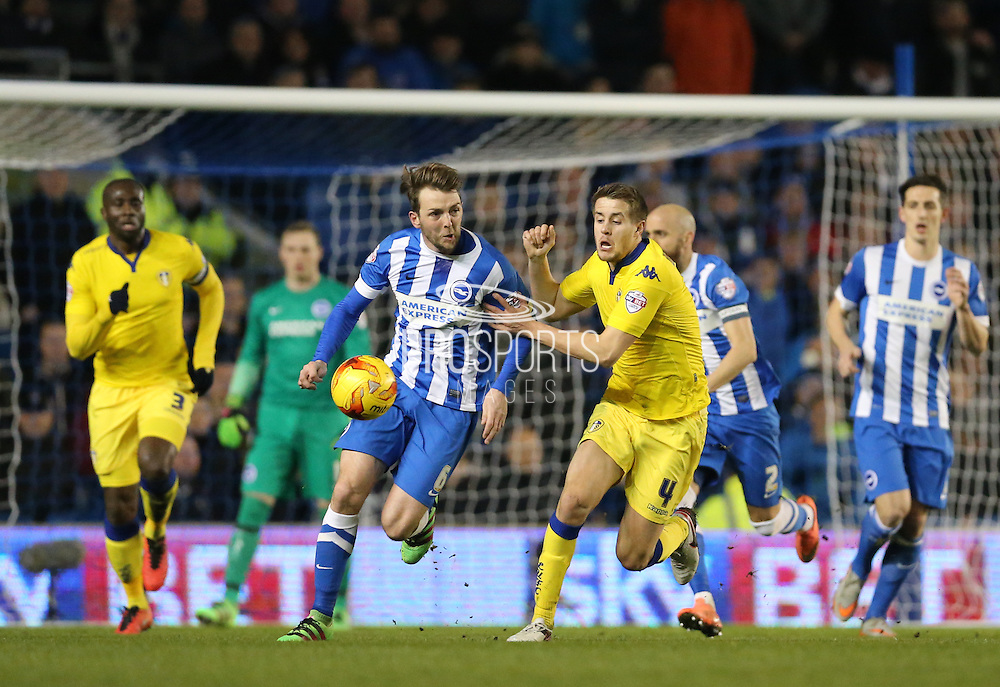 Brighton central midfielder, Dale Stephens (6) and Leeds United defender, Scott Wootton (4) during the Sky Bet Championship match between Brighton and Hove Albion and Leeds United at the American Express Community Stadium, Brighton and Hove, England on 29 February 2016.