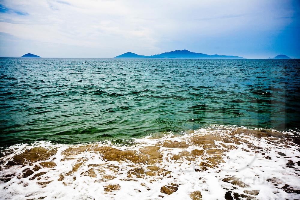 Seascape along Cua Dai Beach with Cham Islands in the far distance, Hoi An, Vietnam, Southeast Asia