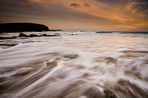 Stunningly beautiful sunset, even though the sun actually set behind me, but the colours left behind, washing all over the white foamy sea was awesome...© Glyn Davies - All Rights Reserved
