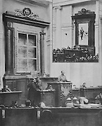 Session of parliament during the Russian Revolution in the Duma chamber - the portrait of Tsar Nicolas II has been removed from its frame and the bronze imperial coat of arms taken from the rostrum and soldiers and officers take the place of politicians, photograph from the front page of L'Illustration no.3867, 14th April 1917. The inset photograph shows a Duma session from 1916 with the former president of the Council Sturmer reading a declaration. Picture by Manuel Cohen