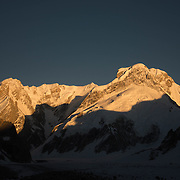 "Sunset on the massif of Chaukhamba. Meaning ""Four Pillars"", the four peaks of Chaukhamba are comprised of sweeping, 6,000 foot walls and massive glaciers that give birth to the Gangotri Glacier and thus the Ganges River."