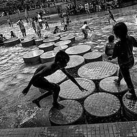 Children play at Kuala Lumpur City Center (KLCC) park in Kuala Lumpur, Malaysia.