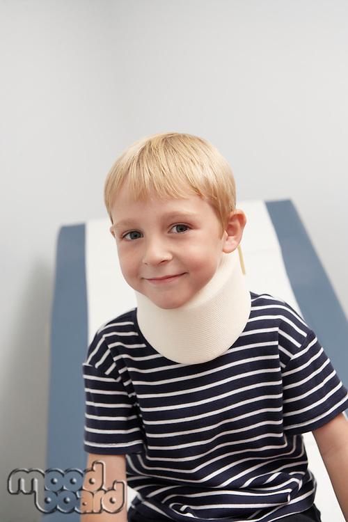 Boy wearing neck brace in hospital,portrait