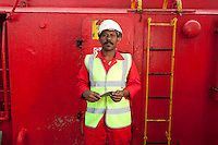 112112/6 Sea People Project - John Gomes, Able Seaman, Union Transport Group plc photographed onboard Union Pluto at Whitstable Harbour